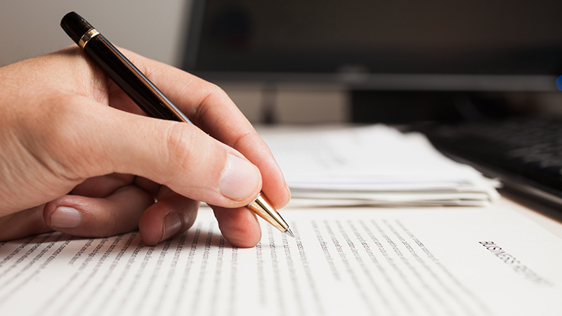 Man checking text on a document